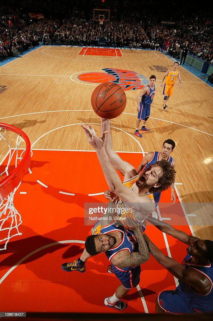 Pau Gasol of the Los Angeles Lakers shoots against Wilson Chandler of the New York Knicks during the game on February 11 2011 at Madison Square...