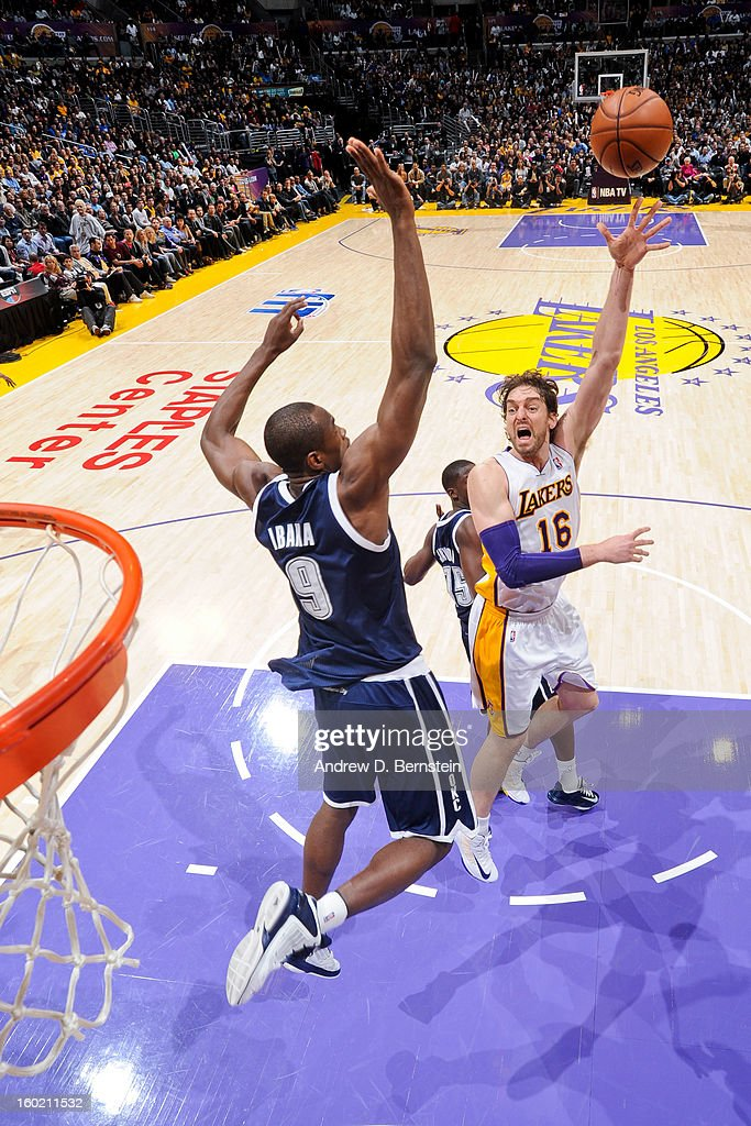 <a gi-track='captionPersonalityLinkClicked' href=/galleries/search?phrase=Pau+Gasol&family=editorial&specificpeople=201587 ng-click='$event.stopPropagation()'>Pau Gasol</a> #16 of the Los Angeles Lakers shoots in the lane against <a gi-track='captionPersonalityLinkClicked' href=/galleries/search?phrase=Serge+Ibaka&family=editorial&specificpeople=5133378 ng-click='$event.stopPropagation()'>Serge Ibaka</a> #9 of the Oklahoma City Thunder at Staples Center on January 27, 2013 in Los Angeles, California.