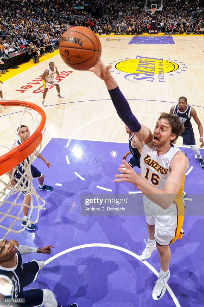 Pau Gasol #16 of the Los Angeles Lakers shoots in the lane against the Oklahoma City Thunder at Staples Center on January 27, 2013 in Los Angeles, California.