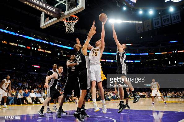 Pau Gasol of the Los Angeles Lakers shoots in the lane against Tim Duncan and Manu Ginobili of the San Antonio Spurs in Game Four of the Western...