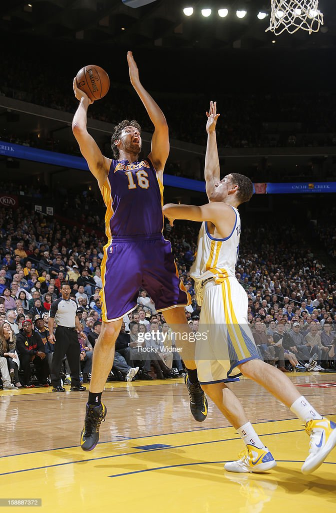 <a gi-track='captionPersonalityLinkClicked' href=/galleries/search?phrase=Pau+Gasol&family=editorial&specificpeople=201587 ng-click='$event.stopPropagation()'>Pau Gasol</a> #16 of the Los Angeles Lakers shoots over <a gi-track='captionPersonalityLinkClicked' href=/galleries/search?phrase=Klay+Thompson&family=editorial&specificpeople=5132325 ng-click='$event.stopPropagation()'>Klay Thompson</a> #11 of the Golden State Warriors on December 22, 2012 at Oracle Arena in Oakland, California.