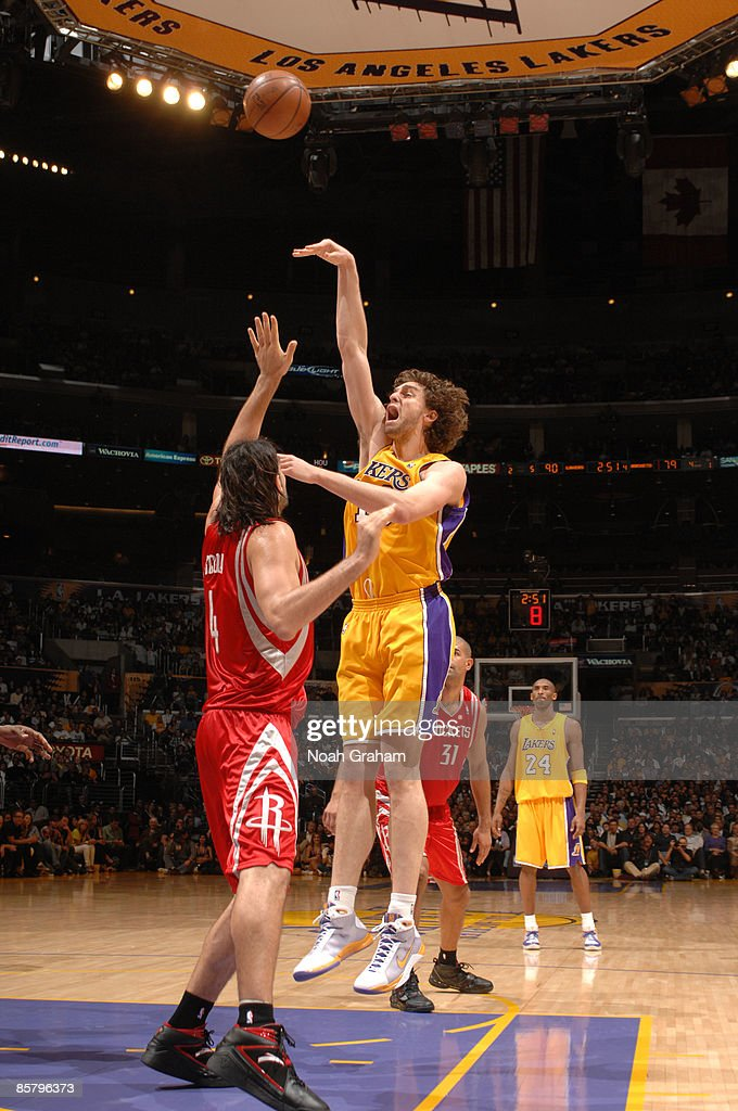 Pau Gasol #16 of the Los Angeles Lakers shoots over Luis Scola #4 of the Houston Rockets at Staples Center on April 3, 2009 in Los Angeles, California.