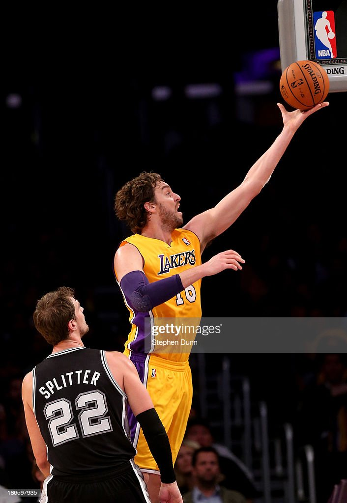 <a gi-track='captionPersonalityLinkClicked' href=/galleries/search?phrase=Pau+Gasol&family=editorial&specificpeople=201587 ng-click='$event.stopPropagation()'>Pau Gasol</a> #16 of the Los Angeles Lakers shoots over <a gi-track='captionPersonalityLinkClicked' href=/galleries/search?phrase=Tiago+Splitter&family=editorial&specificpeople=208218 ng-click='$event.stopPropagation()'>Tiago Splitter</a> #22 of the San Antonio Spurs at Staples Center on November 1, 2013 in Los Angeles, California.