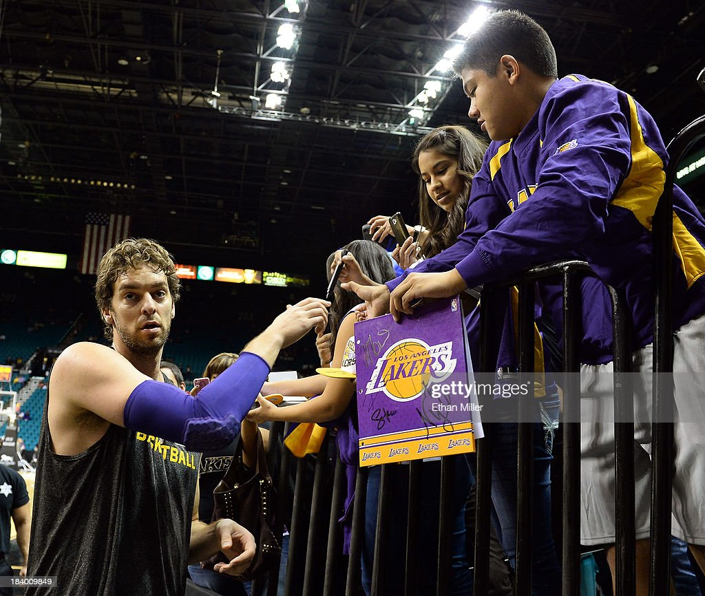 <a gi-track='captionPersonalityLinkClicked' href=/galleries/search?phrase=Pau+Gasol&family=editorial&specificpeople=201587 ng-click='$event.stopPropagation()'>Pau Gasol</a> #16 of the Los Angeles Lakers signs autographs for fans before a preseason game against the Sacramento Kings at the MGM Grand Garden Arena on October 10, 2013 in Las Vegas, Nevada. Sacramento won 104-86.