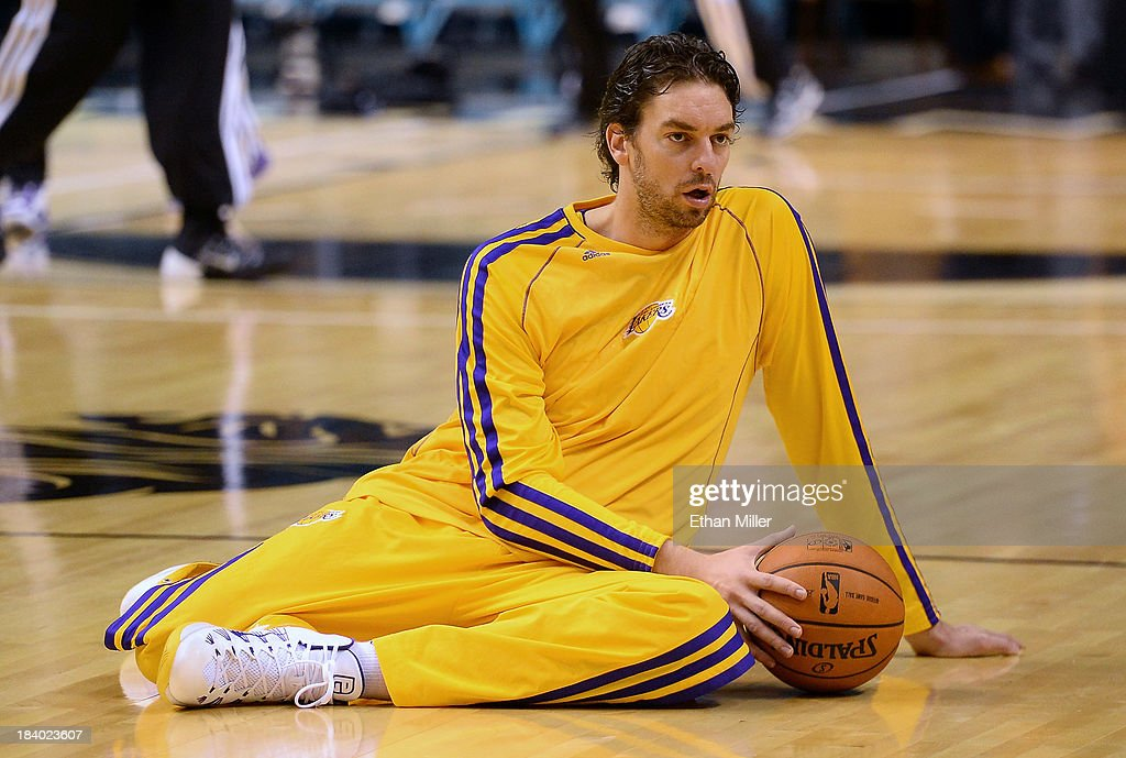 Pau Gasol #16 of the Los Angeles Lakers stretches during warmups before a preseason game against the Sacramento Kings at the MGM Grand Garden Arena on October 10, 2013 in Las Vegas, Nevada. Sacramento won 104-86.