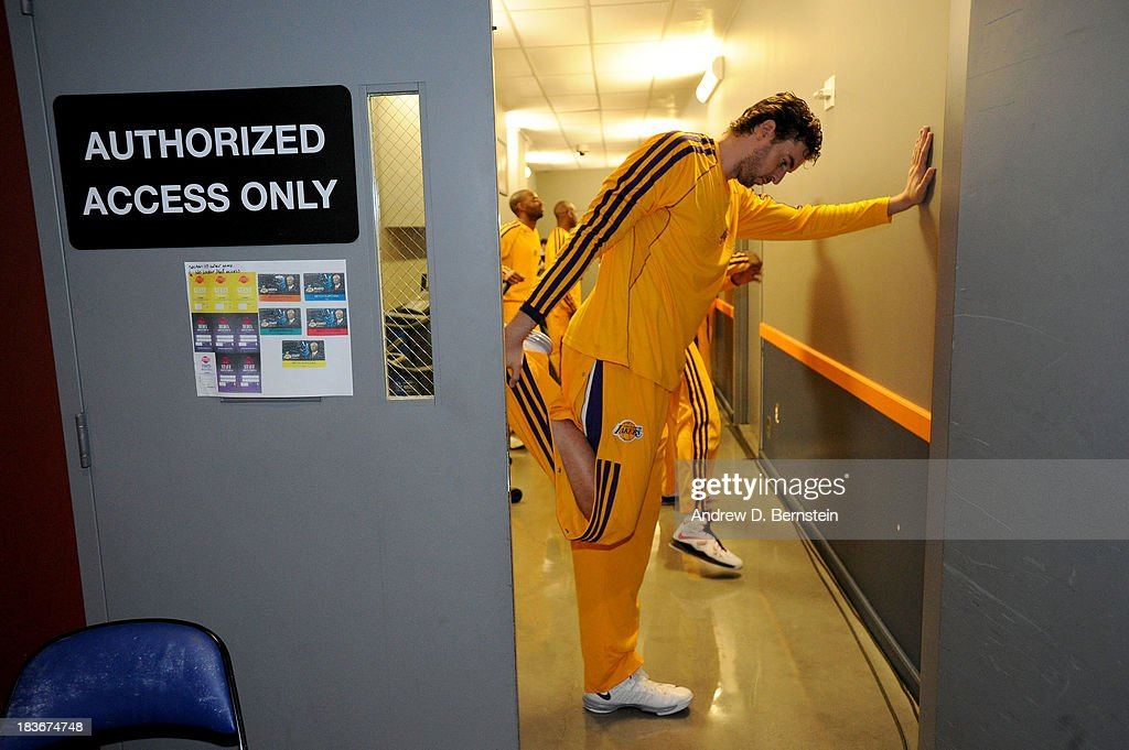 <a gi-track='captionPersonalityLinkClicked' href=/galleries/search?phrase=Pau+Gasol&family=editorial&specificpeople=201587 ng-click='$event.stopPropagation()'>Pau Gasol</a> #16 of the Los Angeles Lakers stretches prior to the game against the Denver Nuggets at Citizens Business Bank Arena on October 8, 2013 in Ontario, California.