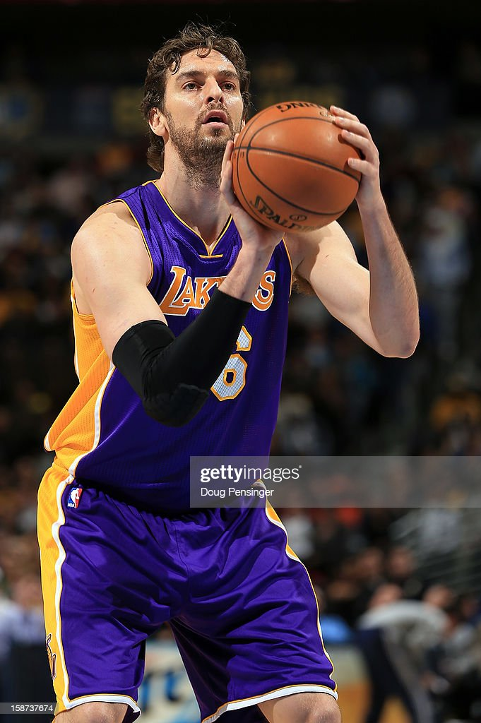 Pau Gasol #16 of the Los Angeles Lakers takes a free throw against the Denver Nuggets at Pepsi Center on December 26, 2012 in Denver, Colorado. The Nuggets defeated the Lakers 126-114.