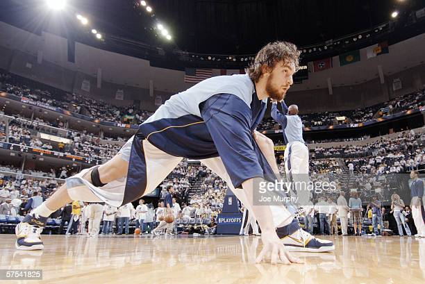 Pau Gasol of the Memphis Grizzlies stretches before play against the Dallas Mavericks in game three of the Western Conference Quarterfinals during...
