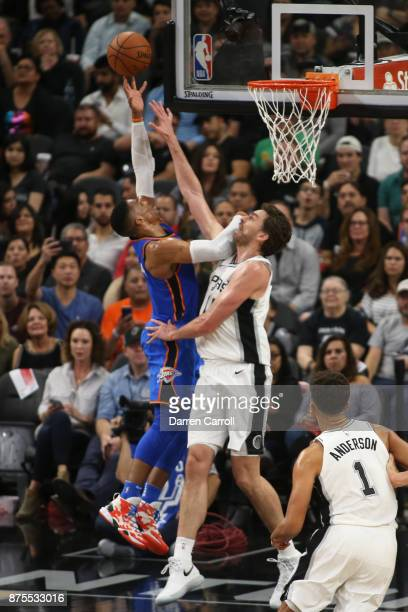 Pau Gasol of the San Antonio Spurs blocks while Russell Westbrook of the Oklahoma City Thunder shoots the ball on November 17 2017 at the ATT Center...