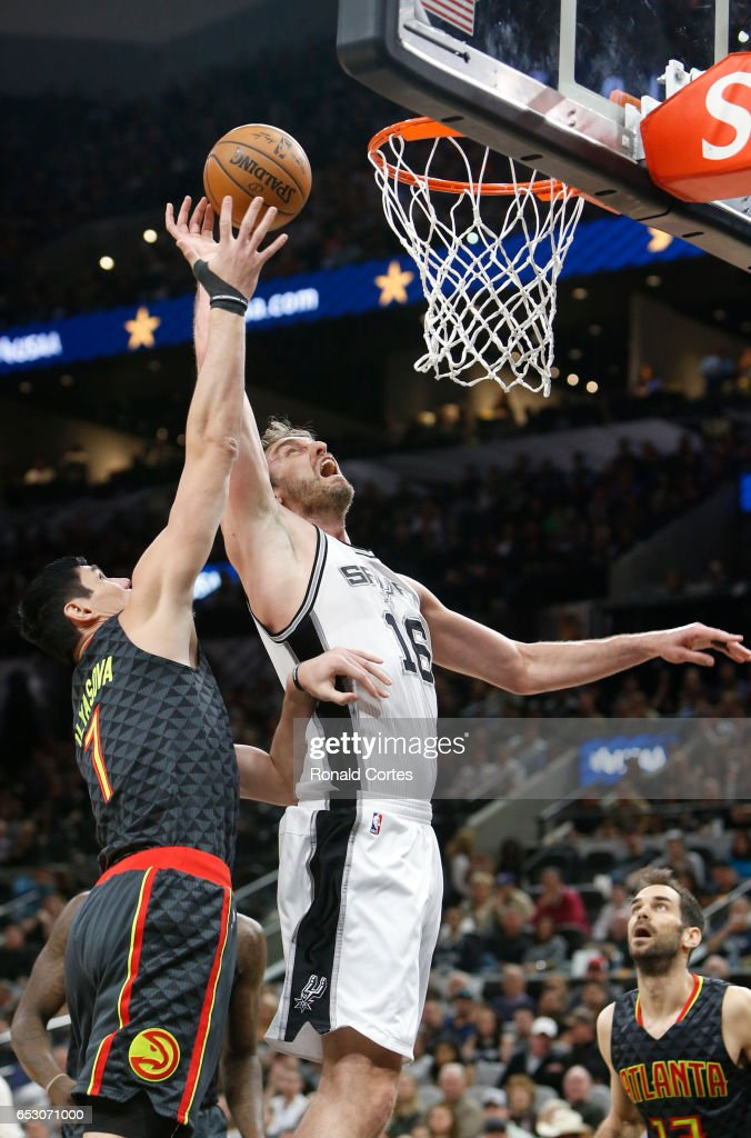 Pau Gasol #16 of the San Antonio Spurs fights for a rebound against Ersan Ilyasova #7 of the Atlanta Hawks at AT&T Center on March 13, 2017 in San Antonio, Texas.
