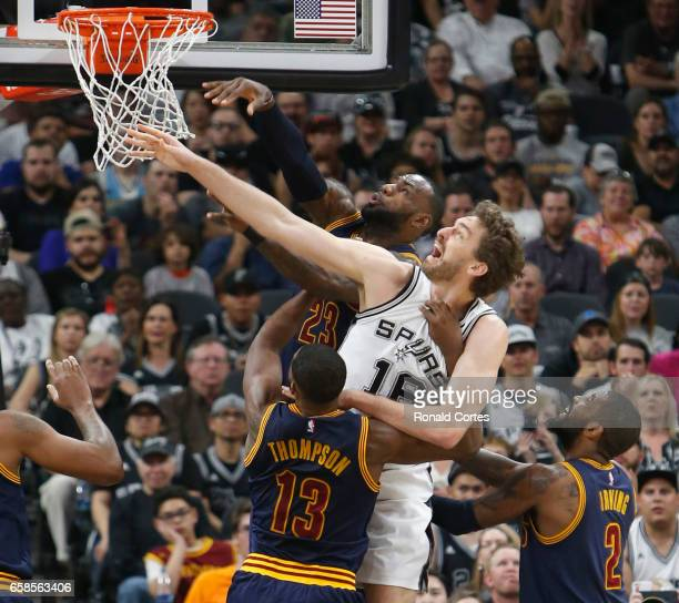 Pau Gasol of the San Antonio Spurs fights LeBron James of the Cleveland Cavaliers for a rebound at ATT Center on March 27 2017 in San Antonio Texas...
