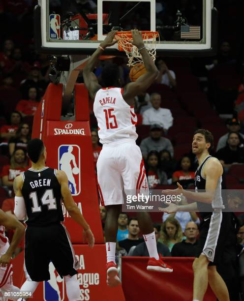 Pau Gasol of the San Antonio Spurs reacts as Clint Capela of the Houston Rockets dunks the ball in the first half at Toyota Center on October 13 2017...
