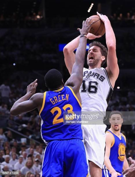 Pau Gasol of the San Antonio Spurs shoots the ball against Draymond Green of the Golden State Warriors in the second half during Game Three of the...