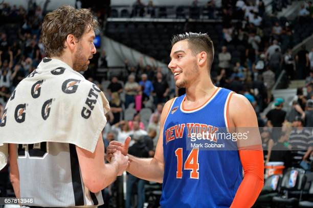 Pau Gasol of the San Antonio Spurs talks with Willy Hernangomez of the New York Knicks after the game on March 25 2017 at the ATT Center in San...