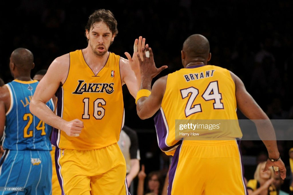 <a gi-track='captionPersonalityLinkClicked' href=/galleries/search?phrase=Pau+Gasol&family=editorial&specificpeople=201587 ng-click='$event.stopPropagation()'>Pau Gasol</a> #16 reacts with teammate <a gi-track='captionPersonalityLinkClicked' href=/galleries/search?phrase=Kobe+Bryant&family=editorial&specificpeople=201466 ng-click='$event.stopPropagation()'>Kobe Bryant</a> #24 of the Los Angeles Lakers in the third quarter while taking on the New Orleans Hornets in Game Five of the Western Conference Quarterfinals in the 2011 NBA Playoffs on April 26, 2011 at Staples Center in Los Angeles, California.