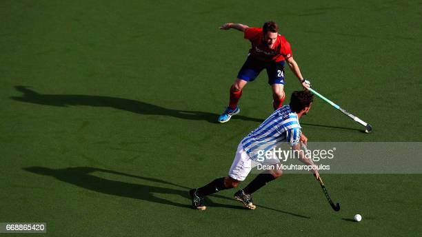 Pau Quemada of Club Egara battles for the ball with Maximilian Neumann of Mannheimer HC during the Euro Hockey League KO16 match between Mannheimer...