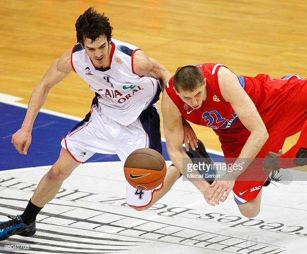 Pau Ribas of Caja Laboral competes with Viktor Khryapa of CSKA Moscow during the Euroleague Basketball 20092010 Play Off Game 2 between CSKA Moscow...