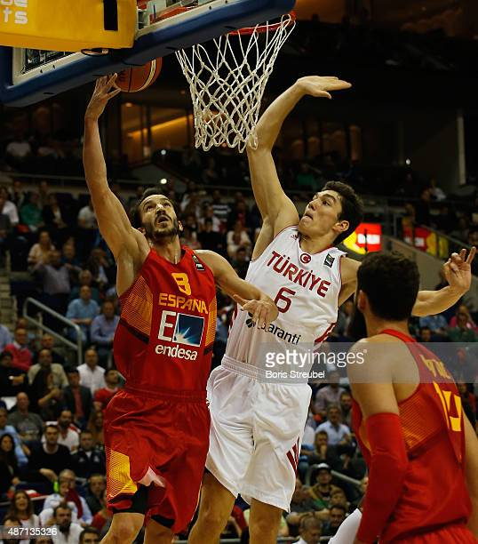 Pau Ribas of Spain drives to the basket against Cedi Osman of Turkey during the FIBA EuroBasket 2015 Group B basketball match between Turkey and...