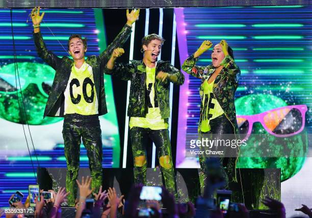 Pau Zurita Juanpa Zurita and Andy Zurita get slimed on stage during the Nickelodeon Kids' Choice Awards Mexico 2017 at Auditorio Nacional on August...