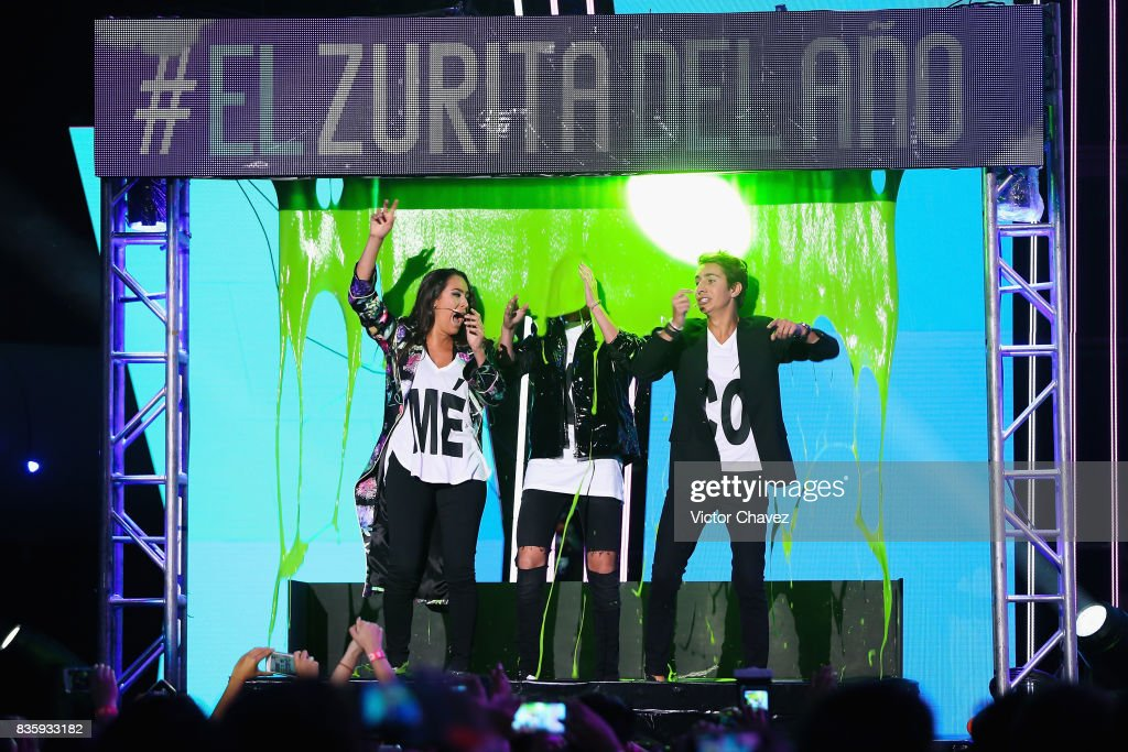 Pau Zurita, Juanpa Zurita and Andy Zurita get slimed on stage during the Nickelodeon Kids' Choice Awards Mexico 2017 at Auditorio Nacional on August 19, 2017 in Mexico City, Mexico.