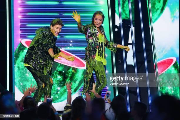 Pau Zurita Juanpa Zurita and Andy Zurita get slimed on stage during the Nickelodeon Kids' Choice Awards Mexico 2017 at Auditorio Nacional on August...