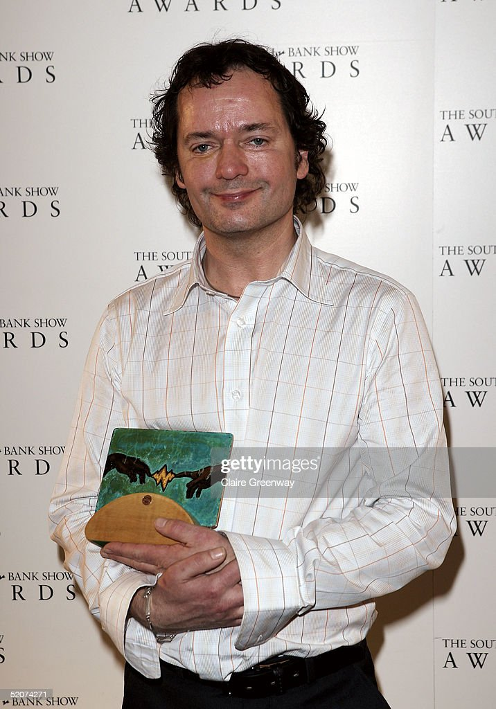 Paul Abbott poses with the Outstanding Achievement award at the South Bank Show Awards at The Savoy on January 27 2005 in London The annual awards...