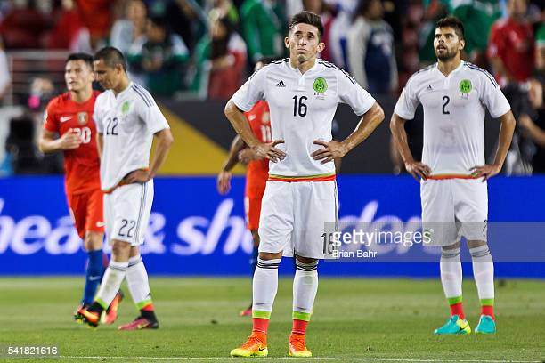 Paul Aguilar Hector Herrera and Nestor Araujo of Mexico react after the seventh of Chile during a Quarterfinal match between Mexico and Chile at...
