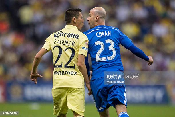 Paul Aguilar of America argues with Laurent Ciman of Montreal Impact during a Championship first leg match between America and Montreal Impact as...