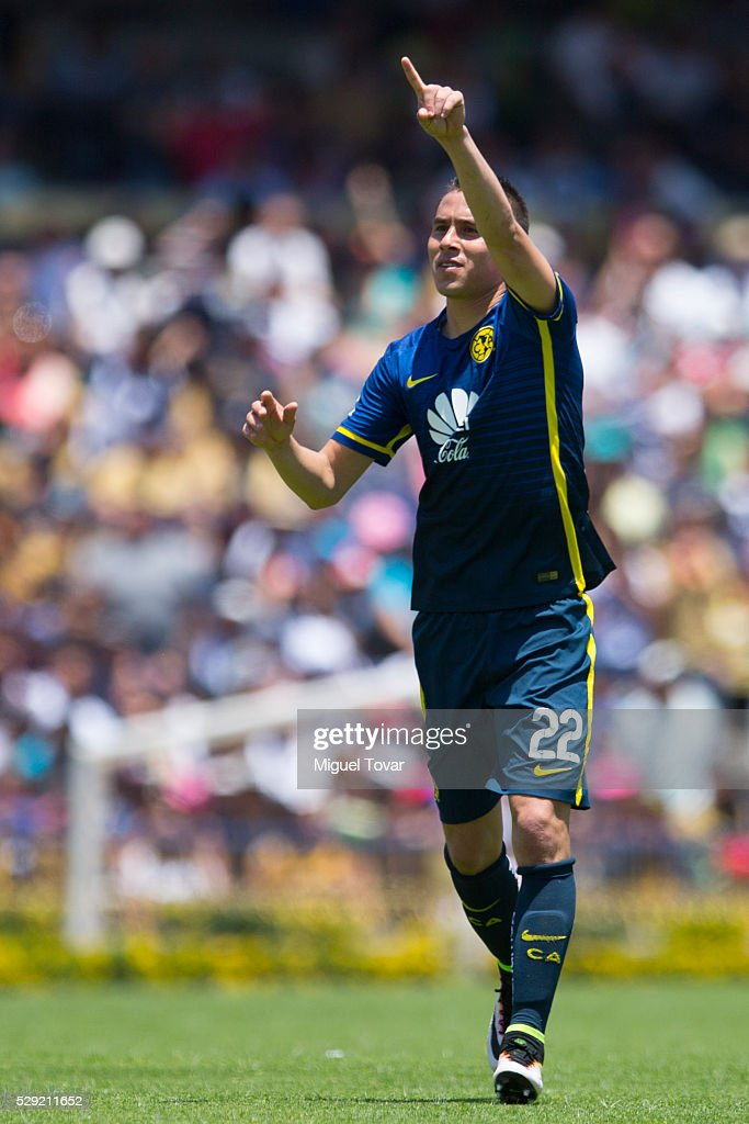 Paul Aguilar of America celebrates after scoring during the 17th round match between Pumas UNAM and America as part of the Clausura 2016 Liga MX at...