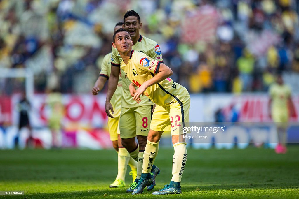 <a gi-track='captionPersonalityLinkClicked' href=/galleries/search?phrase=Paul+Aguilar&family=editorial&specificpeople=4476672 ng-click='$event.stopPropagation()'>Paul Aguilar</a> of America celebrates after scoring the first goal of his team during the 12th round match between America and Chiapas as part of the Apertura 2015 Liga MX at Azteca Stadium on October 03, 2015 in Mexico City, Mexico.