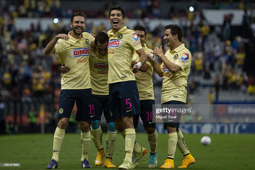 Paul Aguilar of America celebrates with teammates after scoring the second goal of his team during a match between America and Veracruz as part of...