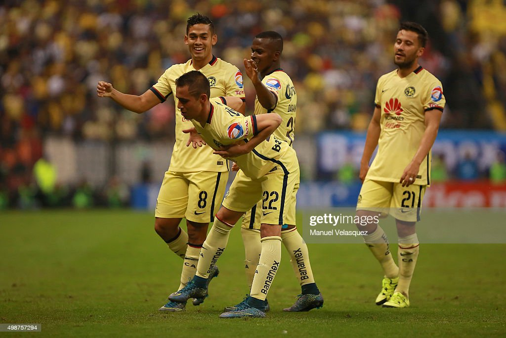<a gi-track='captionPersonalityLinkClicked' href=/galleries/search?phrase=Paul+Aguilar&family=editorial&specificpeople=4476672 ng-click='$event.stopPropagation()'>Paul Aguilar</a> of America celebrates with teammates after scoring the second goal of his team during the quarterfinals first leg match between America and Leon as part of the Apertura 2015 Liga MX at Azteca Stadium on November 25, 2015 in Mexico City, Mexico.