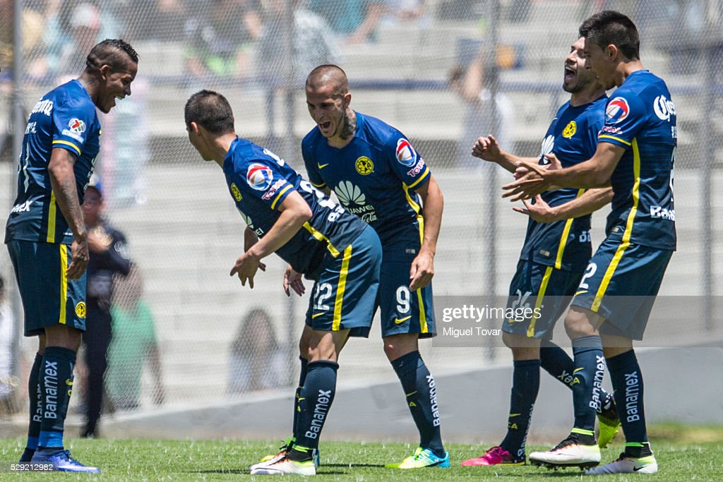 <a gi-track='captionPersonalityLinkClicked' href=/galleries/search?phrase=Paul+Aguilar&family=editorial&specificpeople=4476672 ng-click='$event.stopPropagation()'>Paul Aguilar</a> of America celebrates with teammates after scoring during the 17th round match between Pumas UNAM and America as part of the Clausura 2016 Liga MX at Olimpico Universitario Stadium on May 08, 2016 in Mexico City, Mexico.