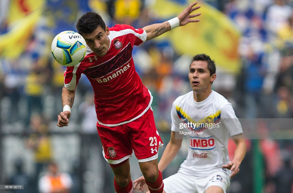 <a gi-track='captionPersonalityLinkClicked' href=/galleries/search?phrase=Paul+Aguilar&family=editorial&specificpeople=4476672 ng-click='$event.stopPropagation()'>Paul Aguilar</a> of America fights for the ball with Hector Acosta of Toluca during a Clausura 2013 Liga MX match between America and Toluca at Azteca Stadium on February 16, 2013 in Mexico City, Mexico.