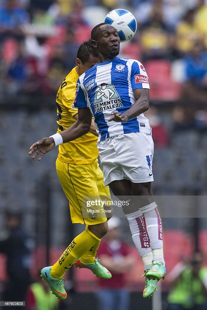Paul Aguilar of America fights for the ball with Walter Ayovi of Pachuca during a match between America and Pachuca as part of the Clausura 2014 Liga...