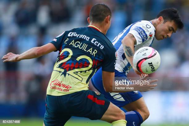 Paul Aguilar of America struggles for the ball with Edson Puch of Pachuca during the 2nd round match between Pachuca and America as part of the...