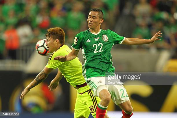 Paul Aguilar of Mexico and Adalberto Peñaranda of Venezuela fight for the ball during a group C match between Mexico and Venezuela at NRG Stadium as...