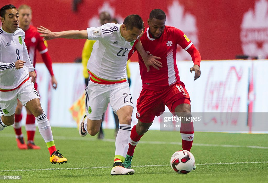 Paul Aguilar of Mexico and David Junior Hoilett of Canada battle for the ball during FIFA 2018 World Cup Qualifier soccer action at BC Place on March...