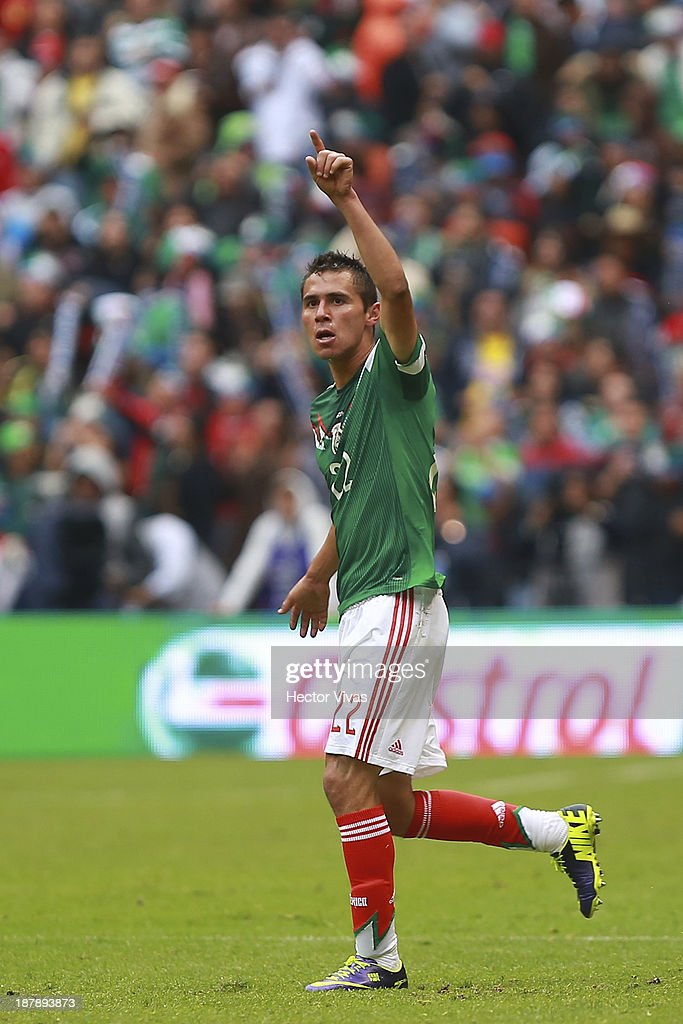 <a gi-track='captionPersonalityLinkClicked' href=/galleries/search?phrase=Paul+Aguilar&family=editorial&specificpeople=4476672 ng-click='$event.stopPropagation()'>Paul Aguilar</a> of Mexico celebrates a scored goal against New Zealand during a match between Mexico and New Zealand as part of the FIFA World Cup Qualifiers at Azteca Stadium on November 13, 2013 in Mexico City Mexico.