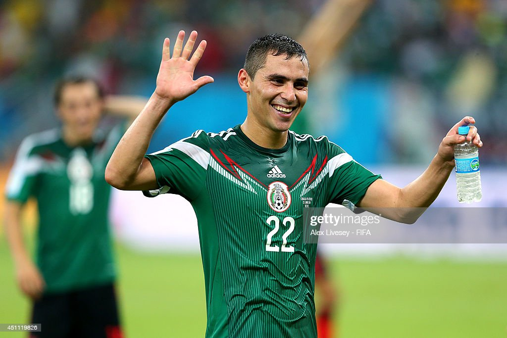 Paul Aguilar of Mexico celebrates after winning the 2014 FIFA World Cup Brazil Group A match between Croatia and Mexico at Arena Pernambuco on June...