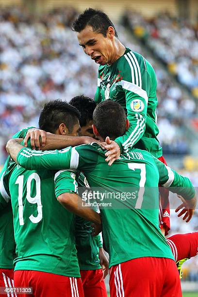 Paul Aguilar of Mexico celebrates Oribe Peralta's goal during leg 2 of the FIFA World Cup Qualifier match between the New Zealand All Whites and...