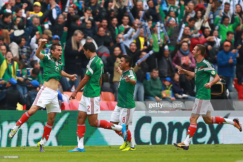 <a gi-track='captionPersonalityLinkClicked' href=/galleries/search?phrase=Paul+Aguilar&family=editorial&specificpeople=4476672 ng-click='$event.stopPropagation()'>Paul Aguilar</a> of Mexico celebrates with his teammates during a match between Mexico and New Zealand as part of the FIFA World Cup Qualifiers at Azteca Stadium on November 13, 2013 in Mexico City, Mexico.