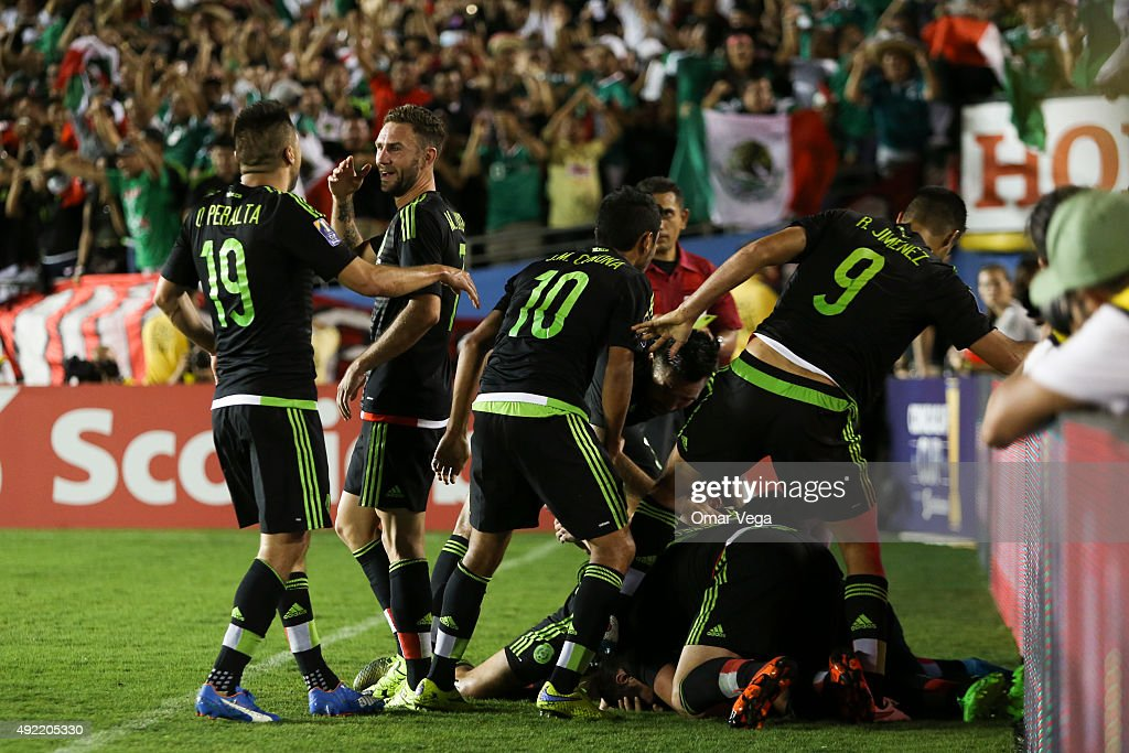 <a gi-track='captionPersonalityLinkClicked' href=/galleries/search?phrase=Paul+Aguilar&family=editorial&specificpeople=4476672 ng-click='$event.stopPropagation()'>Paul Aguilar</a> of Mexico celebrates with teammates after scoring the winning goal of his team during the 2017 FIFA Confederations Cup Qualifier match between USA and Mexico at Rose Bowl Stadium on October 10, 2015 in Pasadena, United States.