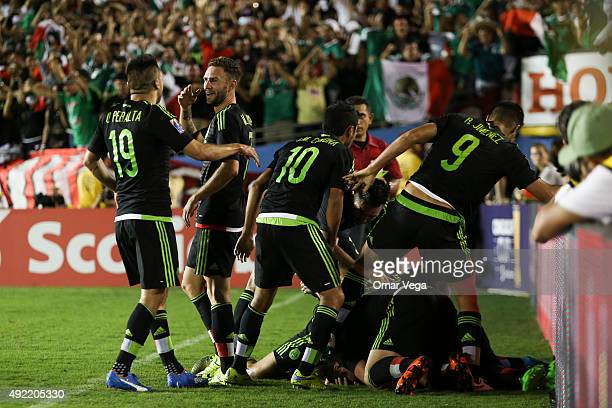 Paul Aguilar of Mexico celebrates with teammates after scoring the winning goal of his team during the 2017 FIFA Confederations Cup Qualifier match...