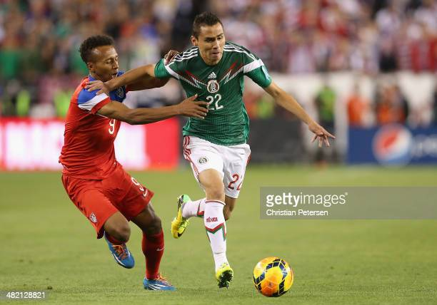 Paul Aguilar of Mexico drives the ball past Julian Green of USA during the second half of the International Friendly at University of Phoenix Stadium...