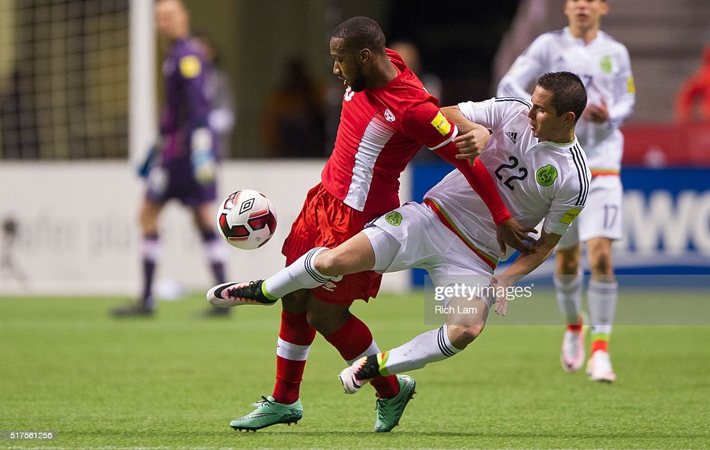 Paul Aguilar of Mexico goes airborne while challenging David Junior Hoilett of Canada for the ball during FIFA 2018 World Cup Qualifier soccer action...
