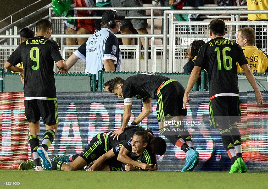 Paul Aguilar of Mexico is mobbed by his teammates after scoring the winning goal to defeat the United States 32 during the 2017 FIFA Confederations...