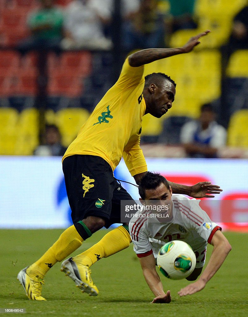 Paul Aguilar (R) of Mexico vies for the ball with Jermaine Johnson (L) of Jamaica during their Brazil-2014 FIFA World Cup CONCACAF football qualifier at Azteca Stadium in Mexico City, on February 6, 2013. AFP PHOTO/Alfredo Estrella
