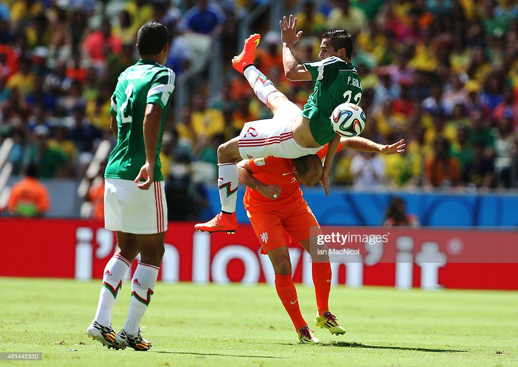 Paul Aguilar of Mexico vies with Arjen Robben of Netherlands during the Round of 16 match of the 2014 World Cup between Netherlands and Mexico at the...