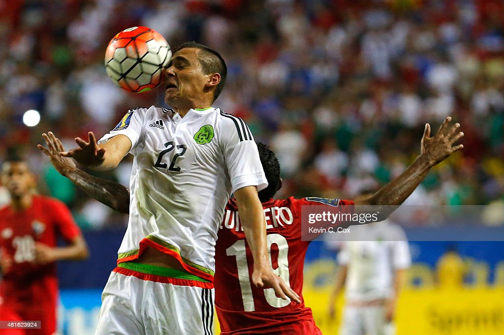 Paul Aguilar of Mexico wins a header against Alberto Quintero of Panama during the 2015 CONCACAF Golf Cup Semifinal match between Mexico and Panama...